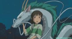 """Szene aus """"Chihiros Reise ins Zauberland"""":Chihiro und ihr Freund Haku in Drachen-Gestalt"""