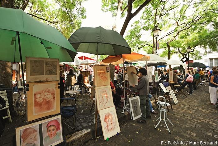 Auf der Place du Tertre bieten Künstler Porträts von Passanten an